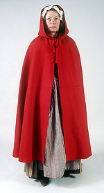 model wearing bright red wool cape with large hood