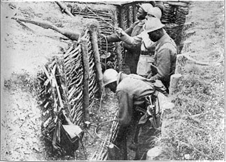 file:/activities/oralhistory/cappics/elliot1917_trenches, alt: several african-american soldiers in a trench