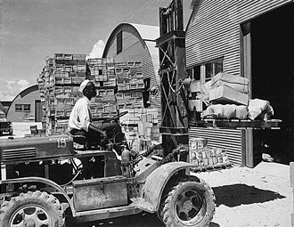 file:/activities/oralhistory/cappics/elliot1939s_forklift, alt: an african-american soldier operating a forklift