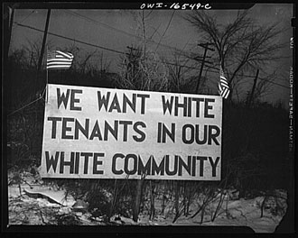file:/activities/oralhistory/cappics/elliot1939s_tenants, alt: roadside sign displaying the words: we want white tenants in our white community